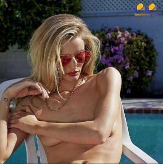 Rosie Huntington-Whiteley posou para as lentes de Collier Schorr com os seios quase à mostra; o ensaio foi feito para a revista de moda V Magazine